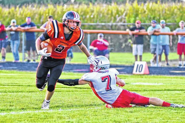 Ansonia's Devyn Sink (2) gets away from a Tri-County North defense in last week's home-opener for the Tigers. Sink leads the team in rushing with 169 yards and one touchdown heading into tonight's contest at Arcanum.