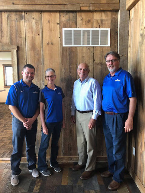Edison State administrators Chad Beanblossom, vice president of regional campuses; Dr. Doreen Larson, president; and Tom Milligan, board of trustees chairman; meet with Bill Dues, president of the Preble County Youth Foundation.