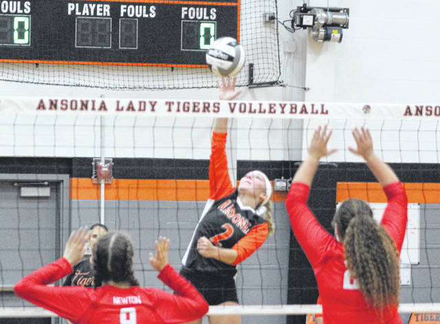 Ansonia's Emily Gariety (2) gets a smash against Newton on Tuesday night in a Cross County Conference volleyball match. The Tigers lost in four games to the Indians.