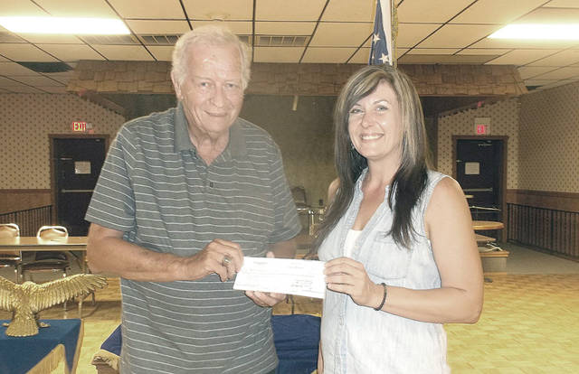 Erica Price, Greenville Eagles 2177 treasurer, presents a second donation check this year to Bob Robinson, program coordinator for Empowering Darke County Youth.