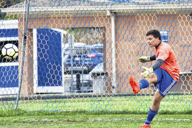 Franklin-Monroe senior Ethan Coppess kicks one out of the goal during a match with Miami East on Thursday. Miami East won the match, 9-2.