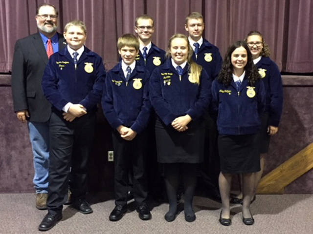 Versailles FFA members who attended the Darke County Farm Bureau Banquet included (front row, l-r) Dawson Petitjean Cress, Cory Timmerman, Courtney Batten, Abby Petitjean, (back row, l-r) Farm Bureau President Matt Aultman, Marcus Berger, Jacob Wuebker and Laura Wuebker.