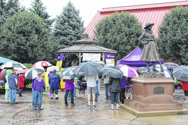 Alzheimer's Walk participants braved a steady rain Saturday in Greenville to promote awareness, and provide support and hope to those living with the debilitating effects of Alzheimer's and dementia.