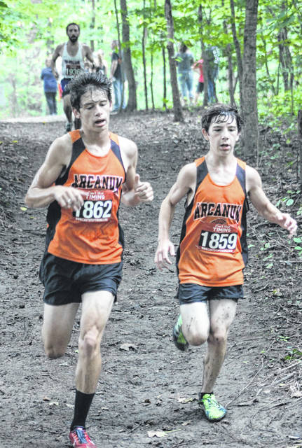 Arcanum's Ethan Moores and Griffin Cates run side-by-side during last week's Blackhawk Invitational at Chenoweth Trails.