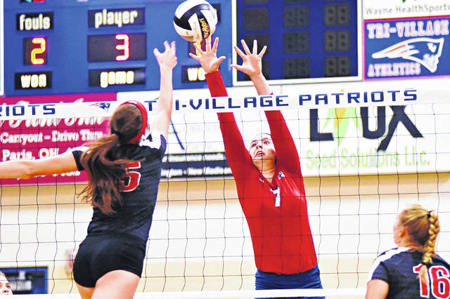 Maddie Downing goes up for a block during Tri-Village's volleyball match Monday night with Preble Shawnee. Downing and the Patriots won the match in three games.
