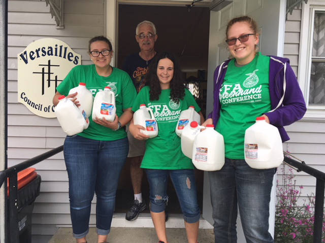 Versailles FFA members who assisted in delivering milk to the Council of Churches as a part of the 10 gallon milk challenge included (l-r) Laura Wuebker, Abby Petitjean and Autumn Petitjean.