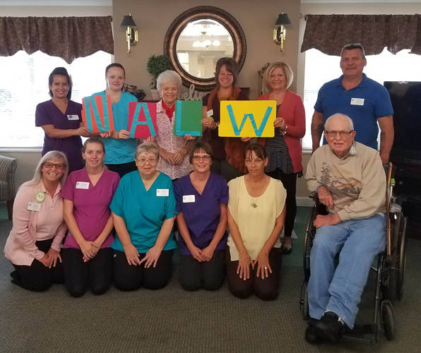Oakley Place is celebrating National Assisted Living Week. Pictured are (back row) Sharon Villesenor; Natalie Weatherly; Barbara Gump, resident ambassador; Alania Dittmar, Sandy Baker, Reuben Yount; (front row) Nikki Nealeigh; Victoria Hofacker; Becky Floyd; Tonya Hines; Carrie Guillozet; and Marion Whittaker, resident ambassador.