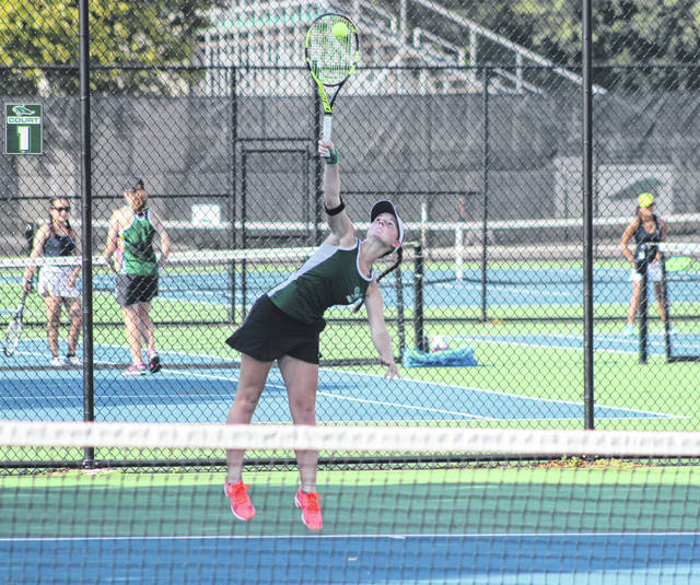 Greenville No. 1 singles player Natalie Milligan sends a serve across the net to her Fairborn opponent McKayla Lyons on Tuesday at the Greenville tennis courts. The Lady Wave won the match 5-0.