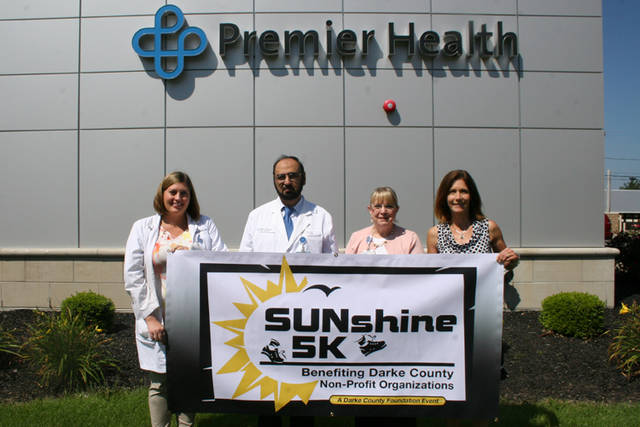 Premier Health is a major sponsor of the SUNshine 5K on Saturday in Greenville Park. Pictured (left to right) are Chelsea Polleys, CNP; Kamran Riaz, MD; Diane Ewing, chief communications officer for Premier Health; and Christy Prakel, director of the Darke County Foundation.