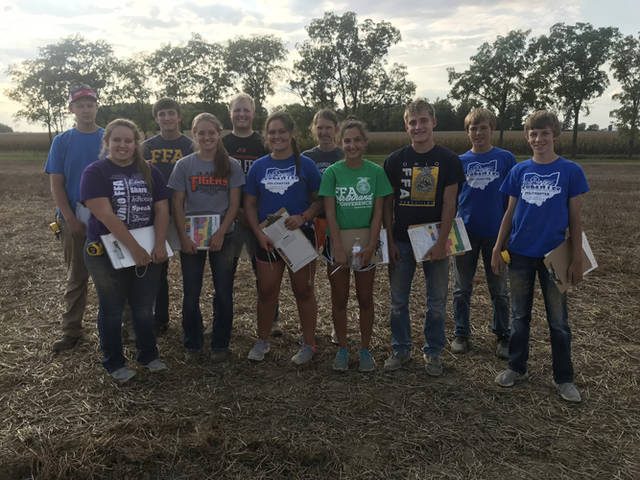 Versailles FFA county soil judging participates included (front row, l-r) Courtney Batten, Caitlyn Luthman, Kayla Bohman, Grace McEldowney, Cole Luthman, Jayden Groff, (back row, l-r) Jacob Wuebker, Alex Kaiser, Dallas Hess, Kimberly Winner and Caleb Kaiser.