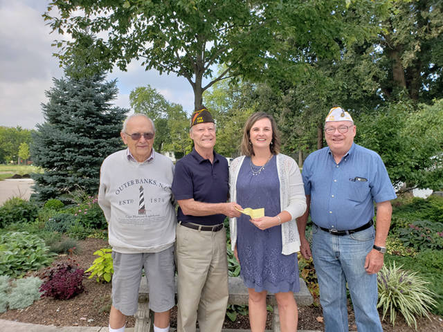 Dwight Emmons, Commander Ron Mills and Vice Commander Don Dietrich, Jr. of Greenville VFW Post 7262 present a check to Andrea Jordan, executive director of the Darke County Center for the Arts.
