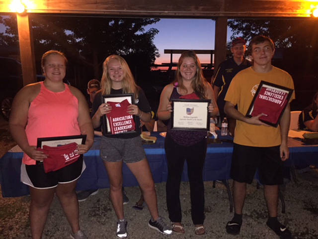 Versailles FFA members (l-r) Shelbie Schmitmeyer, Paige Platfoot, Melissa Gigandet and Troy May were named the Versailles FFA members of the month.