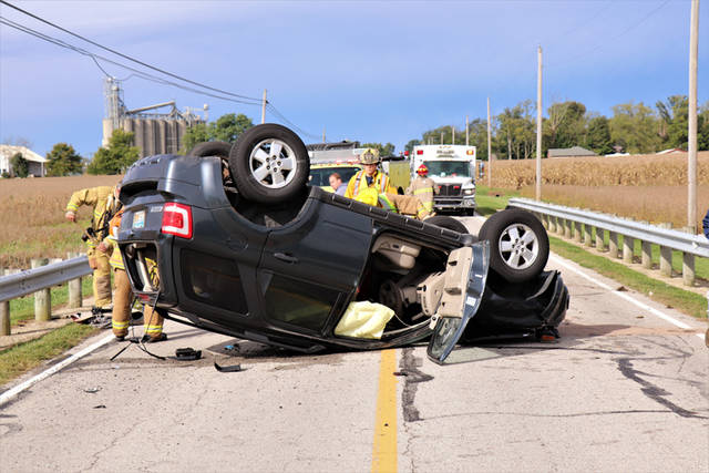 A driver suffered minor injuries after her Ford Escape rolled after striking a guardrail Thursday morning.