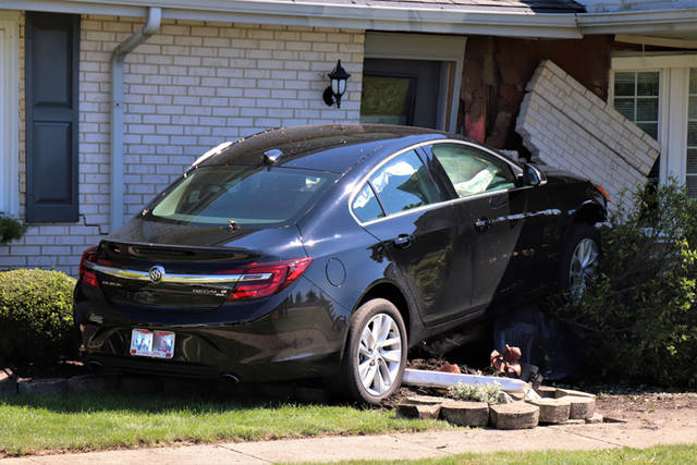 A car crashed into a house on North Broadway on Friday afternoon in Greenville.