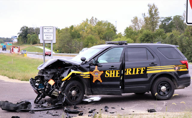 Two Darke County Sheriff's Department deputies were transported to Wayne Healthcare for their injuries following a crash on Thursday.