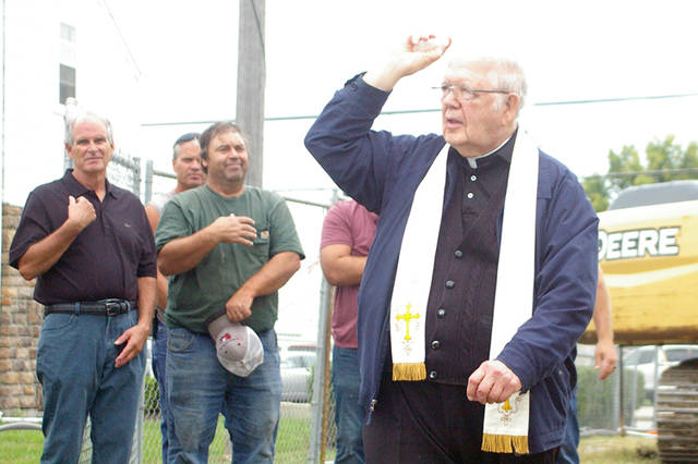 Rev. Charles Mullen from St. Charles Senior Living Community in Carthagena blessed the grounds of Do Good Restaurant and Ministry on Wednesday morning in Osgood.