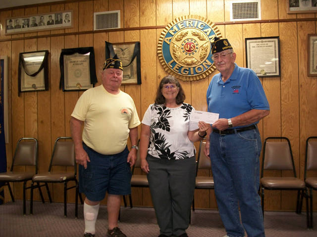 Mercer Savings Bank employee Connie Germann selected American Legion Post 140 to receive a $200 donation as part of the bank's Mission of Giving.