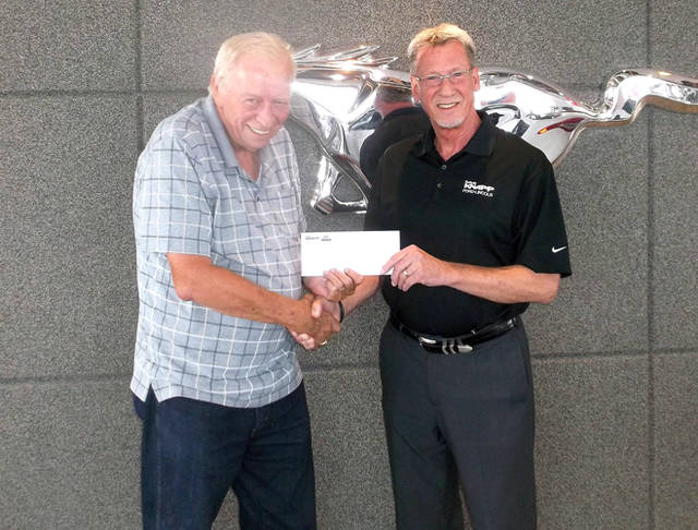 Empowering Darke County Youth Program Coordinator Bob Robinson (left) accepts a check from Dave Knapp, owner of Dave Knapp Ford Lincoln.