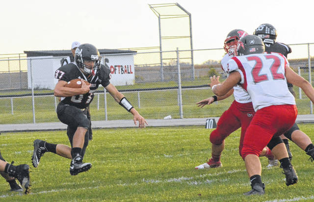 Mississinawa Valley's Will Hall (37) looks for some running room on this play early in the Blackhawks home game against Twin Valley South on Friday night. TVS won the game 25-18.