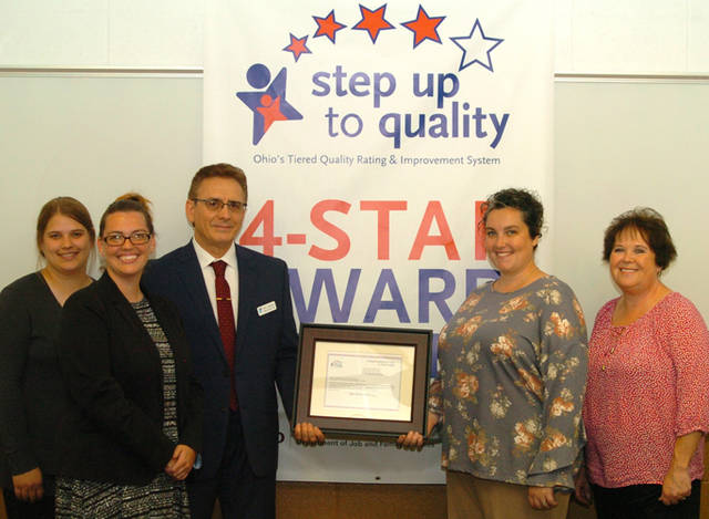 The Darke County YMCA's Child Development Center recently was awarded a four-star rating in the Step Up To Quality program. Pictured are staff (l-r) Sydney Slade, Samantha Cox, CEO Sam Casalano, Assistant CDC Director Rachel Neal and Debbie Ray.