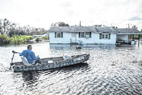 Following Hurricane Florence, Donald Speight looks over the flooding in his neighborhood right outside of Lumberton, North Carolina. Thousands were displaced by the disaster, and family and friends are using services such as the Red Cross virtual call center to be reconnected with them.