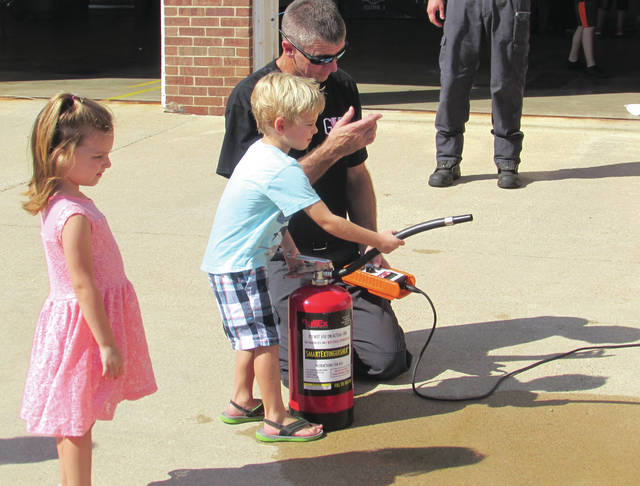 The Greenville Fire Department hosted a Fire Prevention Open House on Sunday at its station inside the Greenville Municipal Building. The event included activities such as guided tours of the fire station, an inflatable tent for kids to explore, demonstrations of proper fire safety equipment use and lectures on topics related to fire safety awareness.