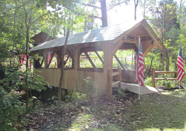The Friends of Bear's Mill held their annual Fall Open House this past weekend. The event included the unveiling of a newly restored timber frame covered bridge dedicated to Darke County's veterans.