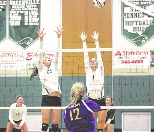 Abbie Yoder (23) and Emma Klosterman (1) go up for a block during a game against Eaton on Monday night. Eaton spoiled the Lady Wave's Senior Night festivities by winning the overall match in five sets, 3-2.