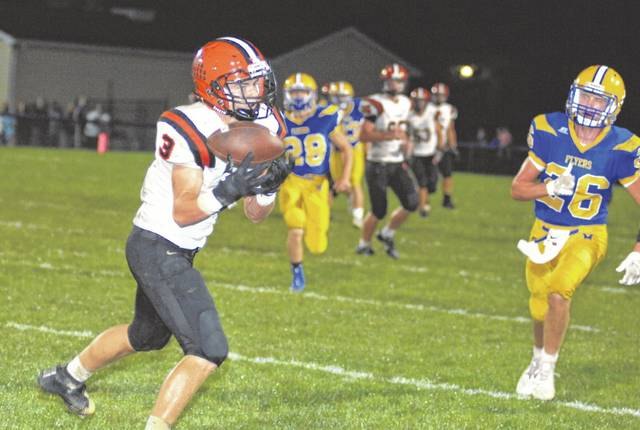 Andrew DeMange makes a catch for Versailles during its road game at Marion Local Friday night. The Flyers defeated the Tigers, 49-14.
