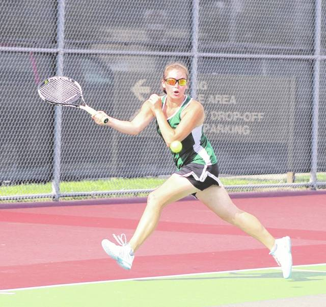 Greenville senior Anna Manges gets a return shot during a Division I sectional doubles semifinal match against Vandalia Butler's Rachel Burton and Victoria Studebaker on Saturday at Troy. Manges and her partner Marabelle Lance won the semifinal match, 6-2, 6-3.