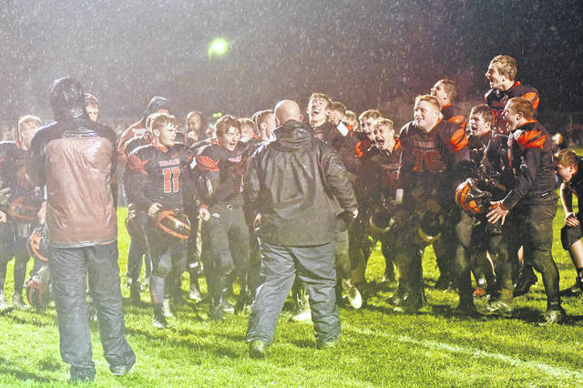 The Arcanum football celebrated after defeating Tri-Village 16-14 on Friday night to end the season on a positive note.