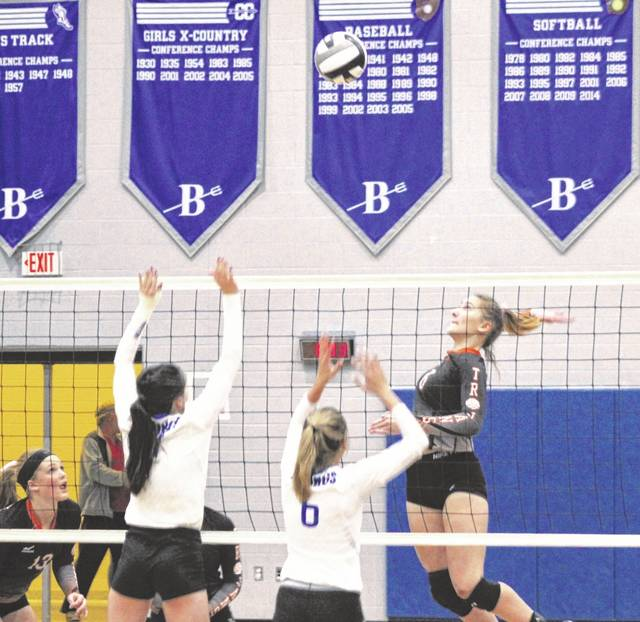 Arcanum junior Audrey Heiser goes for a smash shot against Miami East on Wednesday night in the Division III sectional finals at Brookville. The Vikings won in three sets to advance to the district tournament.