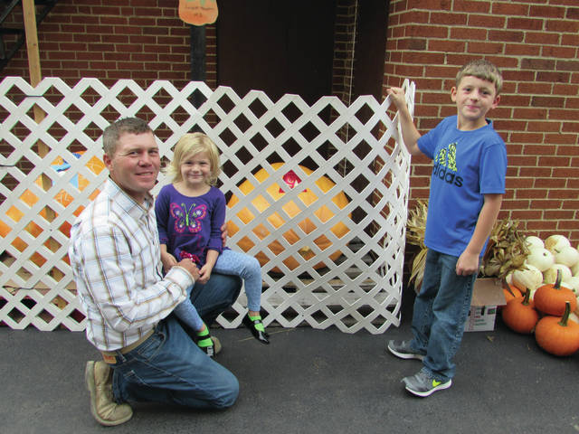 Blake Aultman of the Bradford-Greenville area poses with his children Kinley (middle) and Keegan (right) and their 336 pound pumpkin at the 2017 Bradford Pumpkin Show.
