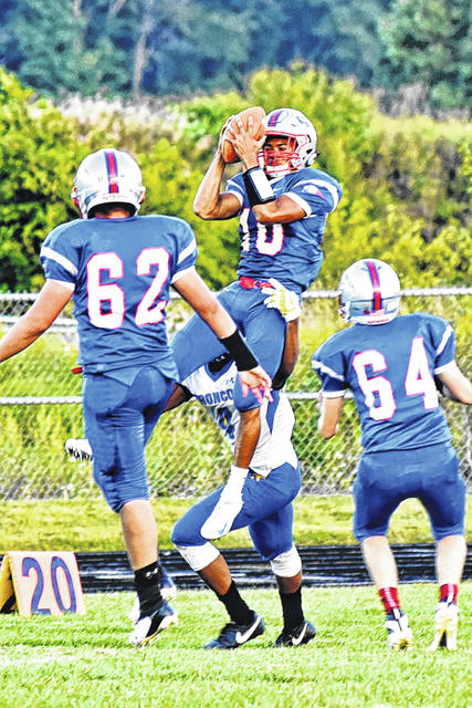 Tri-Village's Austin Bruner intercepts a pass during a game earlier this season. Bruner is among the area leaders in interceptions with 3 through the first seven weeks of the 2018 season.