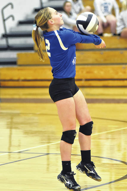 Franklin-Monroe's Belle Cable sets the ball up for a teammate to return during a Cross County Conference volleyball match with Newton on Tuesday. The Lady Jets won the overall match, 3-0.