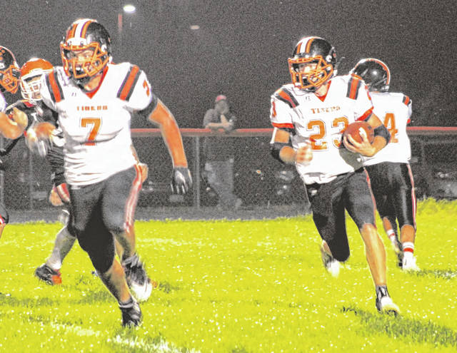 Ansonia's Brock Shellhaas (23) gets behind lead blocker Reece Stammen (7) for a long gain in a game earlier this season. The Tigers (7-2) have unofficially clinched a playoff spot for the second consecutive season.