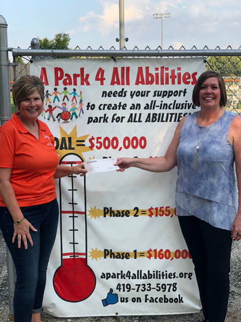 Mercer Savings Bank employee Carmen Meyer selected A Park 4 All Abilities to receive a $200 donation as part of the bank's Mission of Giving.