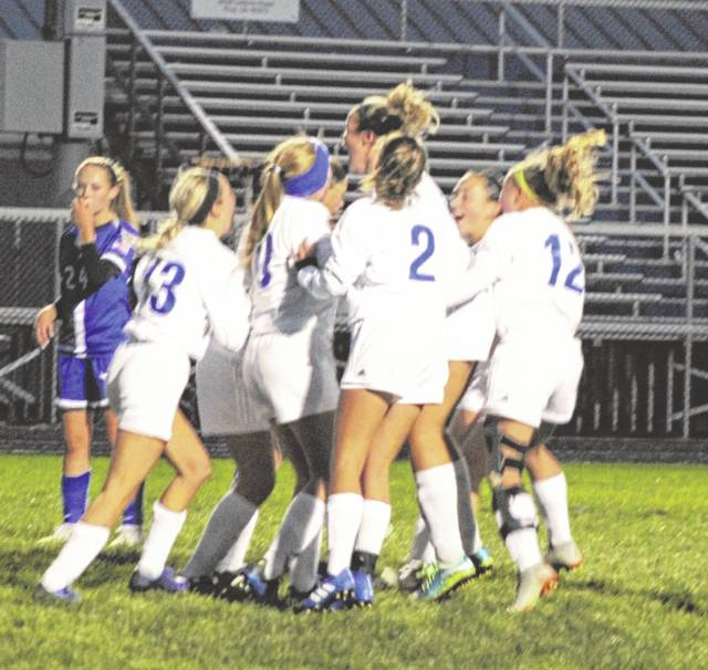 The Franklin-Monroe girls soccer team celebrated after scoring a goal against Miami East on Tuesday night in the Division III sectional tournament. Miami East won the game 5-1 to advance in the tournament.