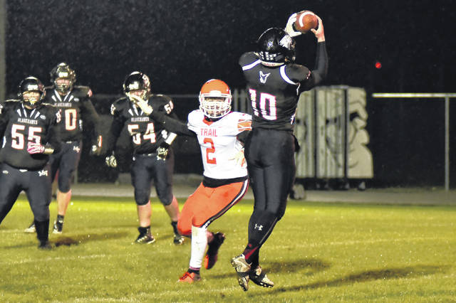 Mississinawa Valley's Cody Dirksen makes a catch over the middle of the field during the Blackhawks home game Friday against National Trail. The Blazers won the game, 41-14.