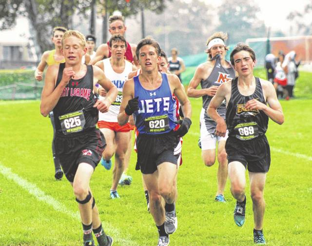 Franklin-Monroe's Cole Good runs with a small pack as they come up to the top of the levy during the Division III boys cross country race on Saturday outside Troy's Hobart Arena. Good placed 11th overall to advance to the state meet for the third consecutive year.