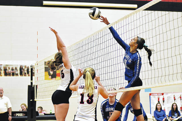 Franklin-Monroe's Corina Conley (in blue) smashes the ball back across the net in a match at Mississinawa Valley on Tuesday night. The Jets won the match in three straight games.