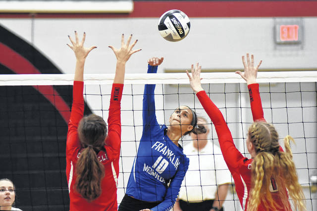 Franklin-Monroe junior Corina Conley (10) gets a kill against Cedarville on Wednesday night in the Division IV sectional tournament at Covington. The Lady Jets swept Cedarville in three sets to win the match and advance to the next round of the tournament at 5 p.m. on Saturday against Houston.