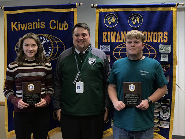 Greenville Kiwanis Club recognized Lauren Dull (left) and Jayce Lovett (right) as its students of the month for September 2018. They are pictured with Greenville High School Principal Stan Hughes.