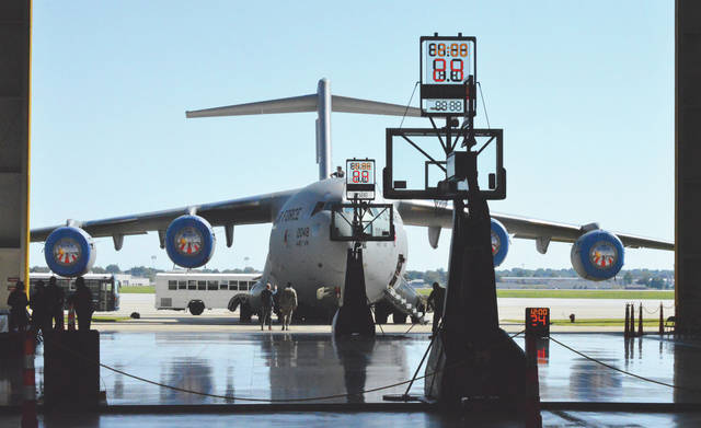 With a Boeing C-17 Globemaster III transport plane serving as a $218 million backdrop, Wright-Patterson Air Force Base's Hangar 4016 was converted into a basketball arena, Sept. 30, for the Cleveland Cavaliers' annual Wine & Gold scrimmage.