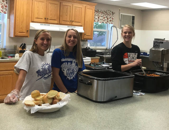 Chloe Brumbaugh, Belle Cable and Chloe Peters were among the Franklin Monroe Student Council members who cooked, served and cleaned on Oct. 3 at the Grace Resurrection Soup Kitchen.