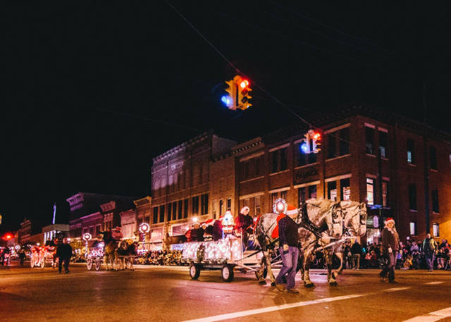 More than 90 festive entries decorated with lights participate in Greenville's Hometown Holiday Horse Parade.