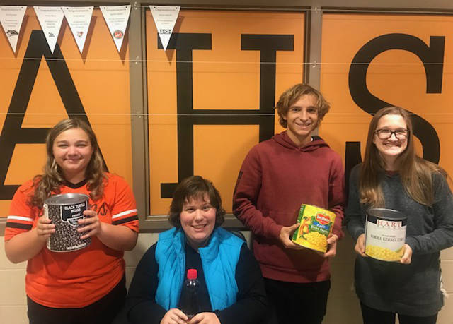 Arcanum High School National Honor students Makenna Gunckel, Mary Trittschuh, Tanner Delk and Celeste Arnett are helping with the Arcanum NHS Trick or Treat Canned Food Drive.