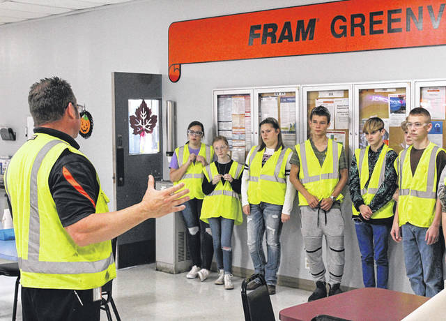 FRAM Plant Manager Jeff Fraelich discusses safety precautions with Greenville High School sophomores during Darke County's Manufacturing Day on Friday.