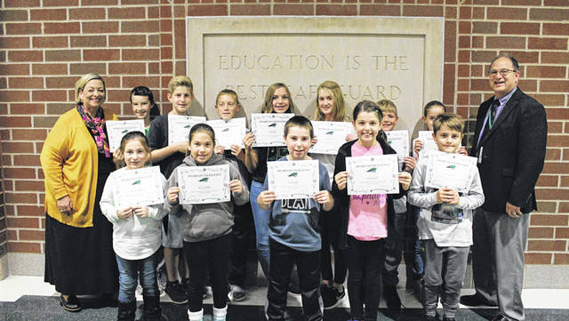 Thirteen Greenville K-8 students achieved perfect scores on the state's AIR Test. Shown with Assistant Superintendent Laura Bemis (left) and Superintendent Doug Fries (right) are Brandon Howard, William Gettinger, Carson Henry, Cali Harter, Erin Leensvaart, Braylon Byers, Tessa Leensvaart, Shyanne Gibboney, Kiera Lecklider, Seth Hughes, Grace Sommer and Henry Stiefel. Student Katelynn Becraft is not pictured.