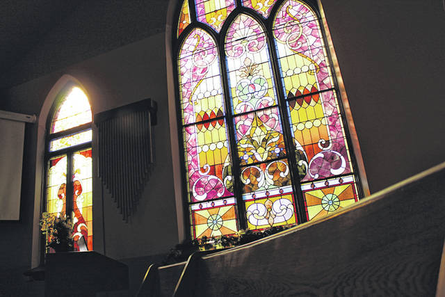 Morning sunlight shines through stained glass at Ansonia Christian Church, which has sat empty on Sundays since the church shut down its ministry Sept. 30.